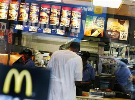A man stands at the counter inside a McDonald's restaurant at the Times Square in New York June 9, 2008. REUTERS/Shannon Stapleton