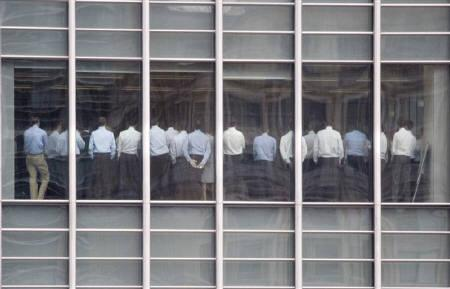 Staff stand in a meeting room at Lehman Brothers offices in the financial district of Canary Wharf in London September 11, 2008. REUTERS/Kevin Coombs