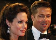 """<p>Cast member Angelina Jolie (L) and actor Brad Pitt leave after the screening of """"The Exchange"""" by U.S. director Clint Eastwood at the 61st Cannes Film Festival May 20, 2008. REUTERS/Vincent Kessler</p>"""