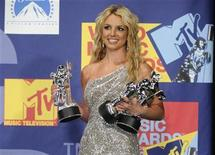 """<p>Britney Spears poses backstage with her three awards for best pop video, video of the year and best female video for """"Piece of Me"""" at the 2008 MTV Video Music Awards in Los Angeles September 7, 2008. REUTERS/Phil McCarten</p>"""
