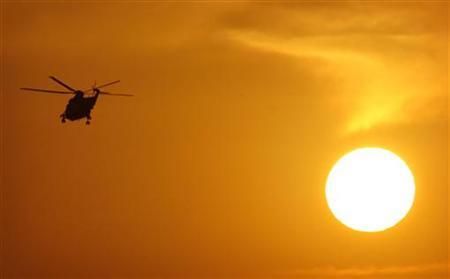 A U.S. helicopter lifts off from Kandahar Air Field at sunset in Kandahar, southern Afghanistan, November 19, 2007. REUTERS/Finbarr O'Reilly