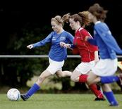 <p>A FC de Rakt player (L) fights for the ball with a Venhorst player during their soccer match in Uden September 14, 2008. REUTERS/Robin van Lonkhuijsen/United Photos</p>