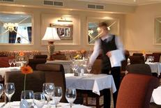 <p>A waiter is seen at a hotel restaurant in a publicity photo. REUTERS/Vismedia</p>