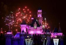 """<p>This file photo shows the premiere of fireworks show, """"Remember Dreams Come True"""", above the Sleeping Beauty Castle during Disneyland's 50th anniversary party at the Disneyland theme park in Anaheim, California May 4, 2005. REUTERS/Fred Prouser</p>"""