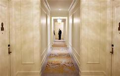 """<p>A man looks down a hallway during a tour of rooms inside """"The Plaza"""" hotel as it re-opens following extensive renovations in New York March 1, 2008. REUTERS/Lucas Jackson</p>"""