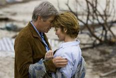 """<p>Actors Richard Gere (L) and Diane Lane are shown in scene from """"Nights In Rodanthe"""" in this undated publicity photo released to Reuters September 23, 2008. In their third screen pairing, Gere, 59, and Lane, 43, play lonely strangers thrown together at a romantic and deserted seaside inn on the North Carolina coast as a storm, both real and emotional, bears down on them. REUTERS/Michael Tackett/Warner Bros./Handout</p>"""