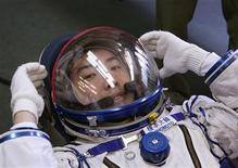 <p>Space tourist Daisuke Enomoto of Japan, who is due to take off from the Baikonur cosmodrome this September, tries on his space suit at an undisclosed factory outside Moscow July 5, 2006. REUTERS/Sergei Remezov</p>