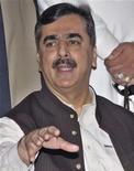 <p>Премьер-министр Пакистана Раза Гилани выступает на пресс-конференции в Мултане, 2 октября 2008 года. После заключения исторического соглашения о партнерстве в мирной ядерной энергетике между Индией и США, Пакистан ждет от Вашингтона аналогичного предложения, сказал премьер-министр страны Юсуф Раза Гилани. (REUTERS/Asim Tanveer)</p>