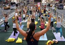 """<p>Participants take part in the """"Summer Solstice in Times Square Yoga-thon"""" in New York June 21, 2007. REUTERS/Brendan McDermid</p>"""