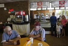 <p>Customers share conversation at The Warrior Hut on Main Street in Honey Grove, Texas October 8, 2008. Owner Ron Ristau, who opened the Warrior Hut on August 21, 2008 says that he's almost doubled business since opening but is still worried about business slowing down at least 15 to 20 percent each day. REUTERS/Jessica Rinaldi</p>