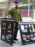 <p>Chinese activist Hu Jia displays photos of Chinese AIDS sufferers from China's Henan province in Beijing in this March 9, 2003 file picture. The European Parliament, in a move certain to rile Beijing, on October 23, 2008 awarded its top human rights prize to Chinese dissident Hu Jia, who was jailed for subversion after testifying to the EU assembly last year. REUTERS/John Ruwitch/Files</p>