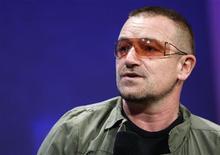 <p>Bono participa de evento social criado pelo ex-presidente dos EUA, Bill Clinton, no dia 24 de setembro em Nova York. Quando 116 milhões de pessoas se manifestaram recentemente contra a pobreza mundial, seu grito coordenado não fez grandes manchetes -- mas inspirou o roqueiro e ativista irlandês Bono a compor uma nova canção para sua banda U2. REUTERS/Chip East</p>
