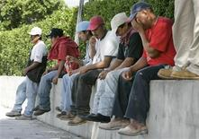 <p>Construction workers gather along a street in hopes of finding work in Miami, October 21, 2008. At the height of Miami's condo construction boom, a stretch of South Dixie Highway south of the city was the place to be for a painter or drywaller looking for work or a contractor looking for workers. But those days are long gone, along with evaporating home values across Florida, and the state that led the nation in job growth during a spectacular real estate boom is diving with a devastating construction bust. REUTERS/Joe Skipper</p>