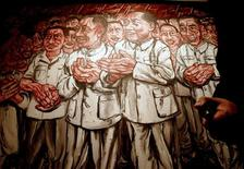 "<p>Zeng Fanzhi's painting ""Mao I: From the Masses, To The Masses"" is introduced during a news conference in Hong Kong in this October 20, 2008 file photo. REUTERS/Woody Wu/Files</p>"