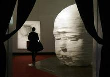 <p>A visitor passes by Vitaly Pushnitsky's sculpture 'Son' displayed at an exhibition during an independent national Russian award in contemporary art Kandinsky Prize at the Central House of Artists in Moscow, November 6, 2008. REUTERS/Denis Sinyakov</p>