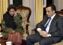 <p>Freed Canadian journalist Mellissa Fung (L) is seated next to Amrullah Saleh, the head of the Afghan National Directorate of Security (NDS), after being released in Kabul November 8, 2008. REUTERS/Intelligence Service Office Handout</p>