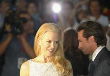 """<p>Hugh Jackman and Nicole Kidman pose together on the red carpet at the world premiere of their new film """"Australia"""" in Sydney November 18, 2008. REUTERS/Tim Wimborne</p>"""