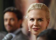 """<p>Nicole Kidman poses before a news conference in Sydney on the day of the world premiere of her new film """"Australia"""", November 18, 2008. REUTERS/Tim Wimborne</p>"""