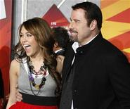 "<p>Actors Miley Cyrus and John Travolta (R) pose at the premiere of their animated film ""Bolt"" from Walt Disney Animation Studios in Hollywood November 17, 2008. . REUTERS/Fred Prouser</p>"
