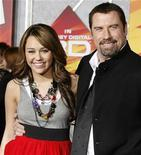 """<p>Actors Miley Cyrus and John Travolta pose at the premiere of their animated film """"Bolt"""" from Walt Disney Animation Studios in Hollywood November 17, 2008. Cyrus and Travolta provide the voices for two of the characters in the film. REUTERS/Fred Prouser</p>"""