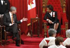 <p>Canada's Governor General Michaelle Jean chats with Prime Minister Stephen Harper (L) prior to the Speech from the Throne in the Senate chamber on Parliament Hill in Ottawa November 19, 2008. REUTERS/Chris Wattie</p>