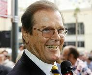 <p>British actor Roger Moore is interviewed after ceremonies unveiling his star on the Hollywood Walk of Fame in Hollywood, California October 11, 2007. REUTERS/Fred Prouser/Files</p>