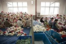 <p>Workers perform quality checks for newly made toys at the production line of a toy factory in the suburbs of Shanghai October 31, 2008. REUTERS/Nir Elias</p>