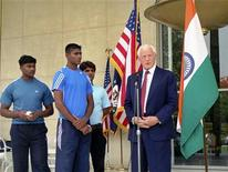 <p>India's Dinesh Patel (L) and Rinku Singh (2nd L), winners of a nationwide baseball pitching contest, watch as U.S. ambassador to India David C. Mulford (R) speaks after handing them visas in New Delhi May 2, 2008. The two Indian teenagers are chasing an American dream as baseball professionals and their promoters hope they can stir up interest in the game in their cricket-mad homeland. REUTERS/U.S. Embassy/Handout</p>