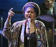 """<p>Odetta sings """"Jim Crow Blues"""" at New York's Radio City Music Hall in a 2003 photo. Odetta, the deep-voiced folk singer whose ballads and songs became for many a soundtrack to the American civil rights movement, has died at age 77, her manager said on Wednesday. REUTERS/Jeff Christensen</p>"""