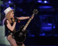 """<p>Madonna performs on stage during her """"Sticky and Sweet"""" tour at the Monumental stadium in Buenos Aires December 5, 2008. REUTERS/Marcos Brindicci</p>"""