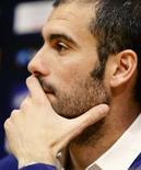 <p>O técnico do Barcelona, Pep Guardiola, fez um alerta para que seus jogadores não subestimem o Real Madrid quando o atual campeão espanhol for ao Camp Nou, no sábado, para a primeira partida do time no Campeonato Espanhol sob comando do técnico Juande Ramos. REUTERS/Gustau Nacarino</p>