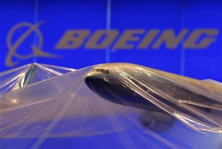 A model of a Boeing aircraft is covered in the southern Chinese city of Zhuhai November 3, 2008. REUTERS/Bobby Yip