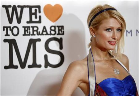 Paris Hilton poses at the 15th annual Race to Erase MS gala in Century City, California May 2, 2008. REUTERS/Mario Anzuoni