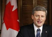 <p>Canadian Prime Minister Stephen Harper poses for a picture in his office on Parliament Hill in Ottawa, after taping a televised statement to the country, December 3, 2008. REUTERS/Chris Wattie</p>