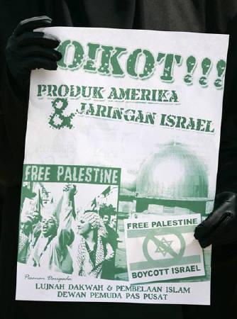 A demonstrator holds a poster during a protest outside the U.S. embassy in Kuala Lumpur January 9, 2009 against Israel's attacks in Gaza. REUTERS/Bazuki Muhammad