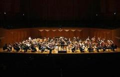 <p>The New York Philharmonic performs during a rehearsal before their concert at the Seoul Arts Centre February 28, 2008. REUTERS/Lee Jae-Won</p>