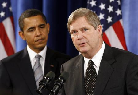 U.S. President-elect Barack Obama (L) listens to former Iowa governor Tom Vilsack, his nominee for secretary of agriculture, during a news conference in Chicago in this December 17, 2008 file photo. REUTERS/Jeff Haynes