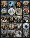 <p>A combination photo shows souvenir buttons displayed for the upcoming U.S. Presidential Inauguration are seen in a store in Washington January 9, 2009. U.S. President-elect Barack Obama will be sworn in as the 44th President of the United States on January 20. Pictures taken January 9, 2009. REUTERS/Molly Riley</p>