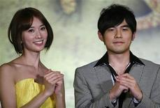 """<p>Taiwanese pop singer Jay Chou (R) and actress Lin Chi-ling attend a news conference to promote their new movie """"Ci Ling"""" in Beijing January 21, 2009. REUTERS/Christina Hu</p>"""