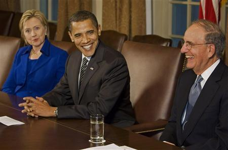 U.S. President Barack Obama (C) meets with Secretary of State Hillary Clinton (L) and Mideast Envoy George Mitchell (R) in the Cabinet Room of the White House in Washington, January 26, 2009. REUTERS/Larry Downing
