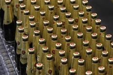 <p>Bottles of beer are seen on the production line at the Fosters Group brewery in Melbourne November 20, 2008. REUTERS/Mick Tsikas</p>