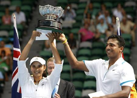 India's Mahesh Bhupathi (R) and Sania Mirza hold up their trophy after winning their mixed doubles final match against Israel's Andy Ram and France's Nathalie Dechy at the Australian Open tennis tournament in Melbourne February 1, 2009. REUTERS/Mick Tsikas