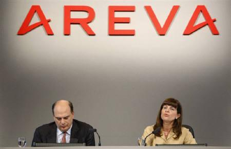 Finance Director Alain-Pierre Raynaud and Anne Lauvergeon (R), chief executive of France's nuclear reactor maker Areva, attend the company's 2007 annual results presentation in Paris in this February 26, 2008 file photo. REUTERS/Jacky Naegelen/Files