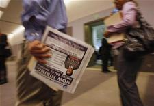 <p>People walk around booths with job recruiters at a career fair in Los Angeles February 3, 2009. REUTERS/Lucy Nicholson</p>