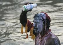 <p>A Hindu devotee pours milk on himself before beginning his pilgrimage to the sacred Batu Caves temple during Thaipusam festival in Kuala Lumpur, February 8, 2009. REUTERS/Zainal Abd Halim</p>