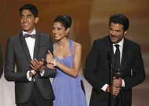"<p>Actors Dev Patel (L), Freida Pinto (C) and Anil Kapoor accept the award for Outstanding Performance by a Cast in a Motion Picture for ""Slumdog Millionaire"" at the 15th annual Screen Actors Guild Awards in Los Angeles January 25, 2009. REUTERS/Lucy Nicholson</p>"