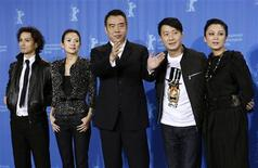 """<p>Actors Ando Masanobu, Zhang Ziyi, director Chen Kaige, Leon Lai and Chen Hong (L-R) pose during a photocall to promote the movie """"Forever Enthralled"""" at the 59th Berlinale film festival in Berlin, February 10, 2009. REUTERS/Fabrizio Bensch (GERMANY)</p>"""