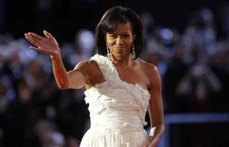U.S. first lady Michelle Obama waves to the crowd after dancing her first dance of inauguration night with President Barack Obama at the leadoff Neighborhood Inaugural Ball in Washington, January 20, 2009. REUTERS/Brian Snyder