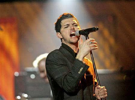 Singer J.D. Fortune is seen performing with music group INXS during the ''VH1 Big in '05'' awards show in Culver City, California, in this December 3, 2005. REUTERS/Mario Anzuoni/Files