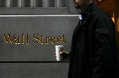 <p>A man passes in front of a sign on Wall Street in New York, February 10, 2009. REUTERS/Eric Thayer</p>